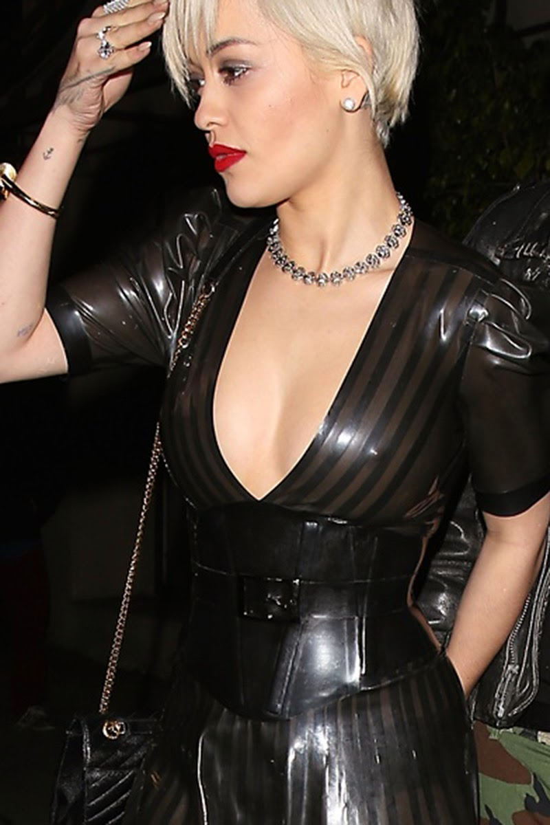 Rita Ora in a plunging latex dress on dinner date with boyfriend Ricky Hil