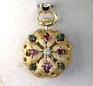 http://www.ebay.com/itm/Vintage-diamond-ruby-tourmaline-watch-pendant-14K-yellow-gold-1-05CT-hearts-9-8G-/231932253856?hash=item36003d56a0