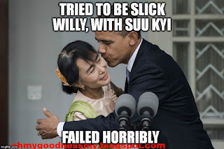 Obama kiss Suu Kyi