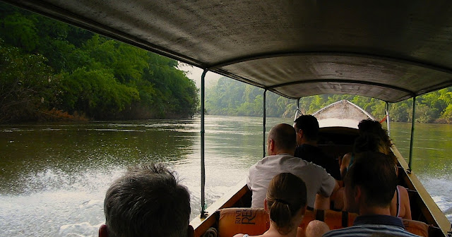 On a longtail boat over the River Kwai in Kanchanaburi - Thailand
