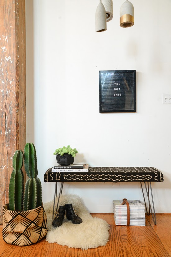 Safari Fusion blog | Obesssion: Mud cloth | Wire leg bench seat upholstered in black Bogolan fabric via Homepolish