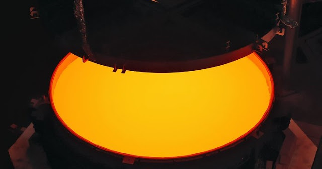 Opening of the ELT M2 ZERODUR® blank mould containing the still very hot ZERODUR® glass at first annealing at the SCHOTT 4-metre blank annealing facility in Mainz, Germany in May 2017. The completed mirror will be 4.2 metres in diameter and weigh 3.5 tonnes. It will be the largest secondary mirror ever employed on a telescope and also the largest convex mirror ever produced.  Credit: SCHOTT/ESO