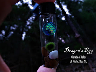 Dragon's Egg Marimo Vial; The Dragon's Egg at dusk in the woods looks magical doesn't it?