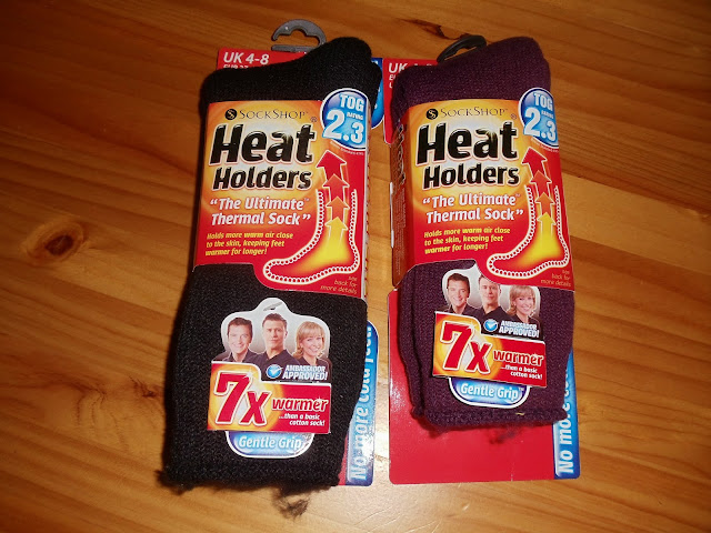 two pairs of heat holders socks in their packaging