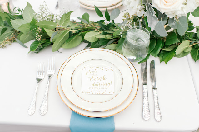 Foliage place setting at table for guests