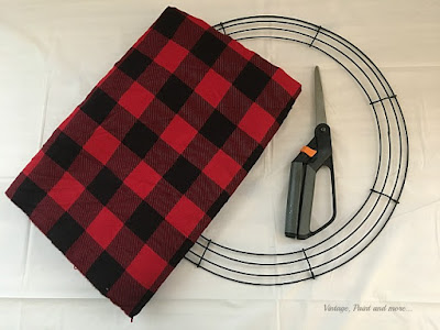 Vintage, Paint and more... only 3 things needed to make a wonderful rag wreath for Christmas.  Buffalo plaid flannel fabric, scissors, and a wire wreath form.