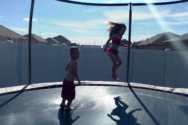 Sprinklers under the trampoline is a great way to cool off and burn off some energy.