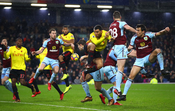 Troy Deeney of Watford wins a header from a cross during the Premier League match between Burnley and Watford at Turf Moor on December 9, 2017 in Burnley, England. (Photo by Clive Brunskill/Getty Images)