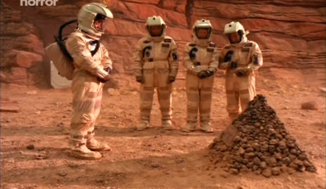 Funeral for one of the five astronauts - Escape from Mars movie image