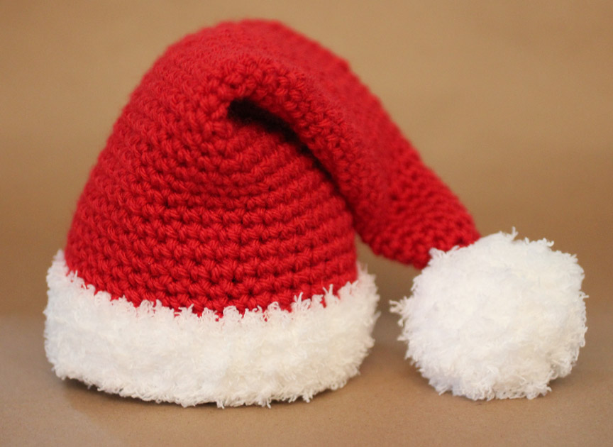 9f488dde25986 I followed the Crochet Santa Hat Pattern from Girl In Air. She provides a  pattern for newborn – adult sizes! The only thing you have to figure out is  how ...