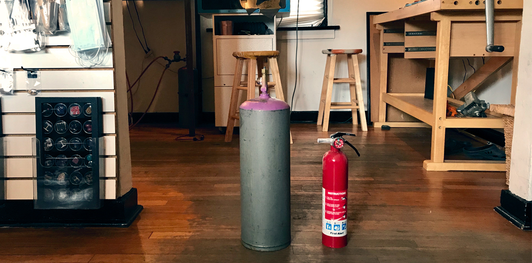 Harold Studio Acetylene tank and a fire extinguisher