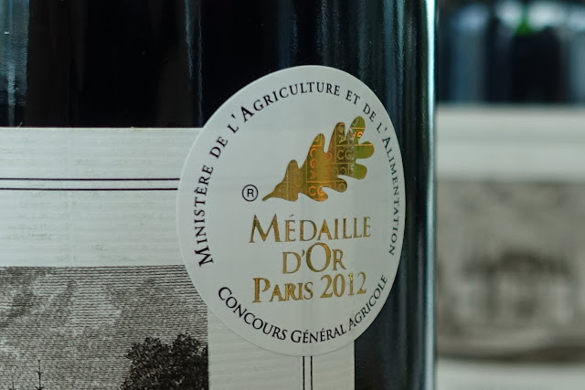 "A close up of a sticker on a bottle saying ""Medaille D'Or Paris 2012"""