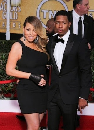 Mariah Carey hires security to watch her husband, Nick Cannon