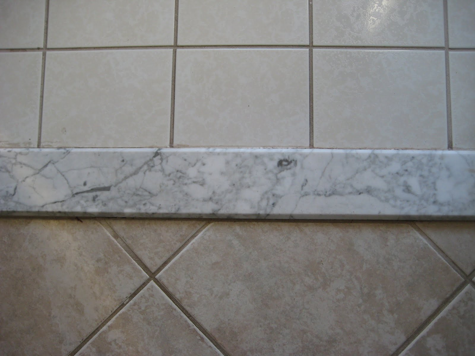 Tile Saddle - the divider piece between two tiled rooms. Tips for re-tiling a bathroom