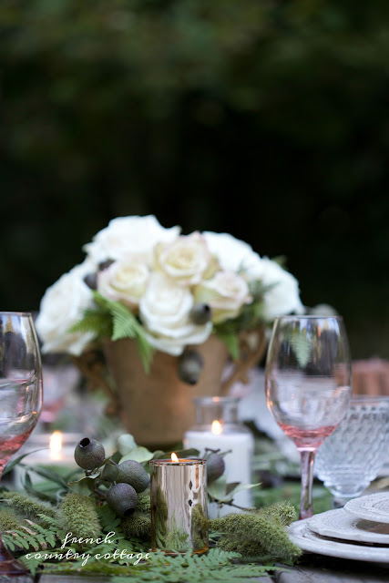 roses and greens on outdoor table