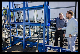 Grant Mize and Jim Toussaint examine a new glass hauling rack at Moore Freight in Mascot, Tennessee