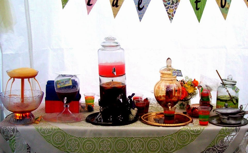 teas, punches and infused waters are served on a lace tablecloth for the bridal shower