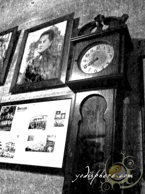 hover_share Old antique clock and old photos displayed inside the Ruins in Talisay City Negros Occidental