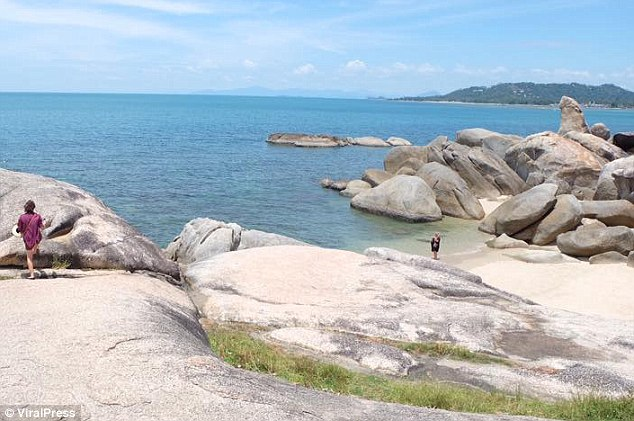 The Hin Ta rock, seen far right, is considered sacred by the residents of Koh Samui, and many are now demanding that the woman is arrested and made to apologise.