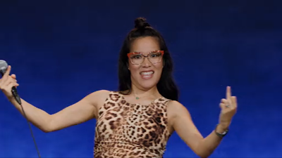 comedy special - Ali Wong: Hard Knock Wife - Ali Wong holds her her middle fingers