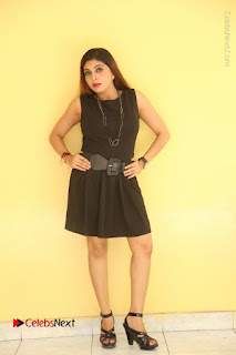 Tollywood Upcoming Actress Pooja Roshan Stills in Black Short Dress at Plus 1 Movie Trailer Launch  0234.JPG