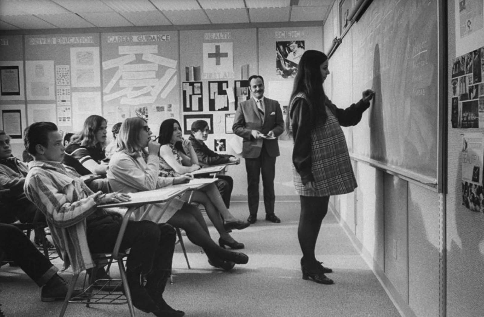At Citrus High School in California, honor student Judy Fay worked at the blackboard during an English class.
