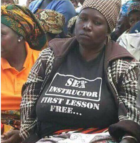 Check out the weird inscription on this woman's shirt
