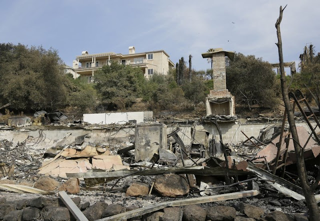 Houses spared by massive fires