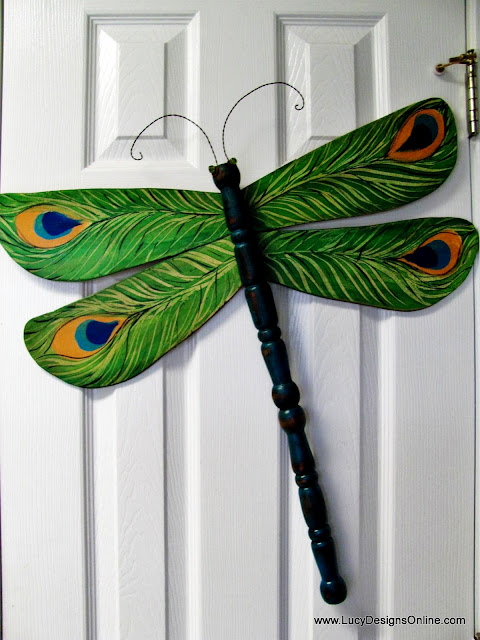 Lucy Designs Peacock feather design on dragonfly