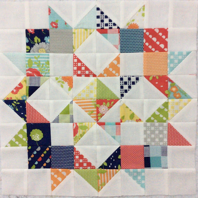 photo of a moda love mini charm quilt made in Bonnie and Camille Happy Go Lucky
