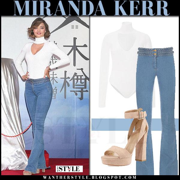 Miranda Kerr in white cushnie et ochs bodysuit and flared jeans veronica beard what she wore
