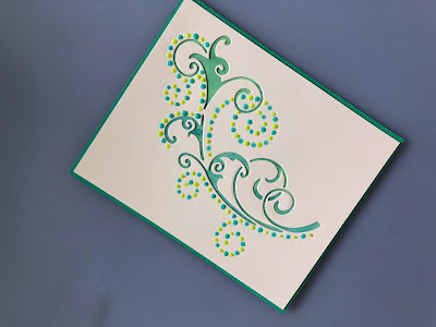Dot and Drop die cut with Nuvo Drops on Distress Oxide background