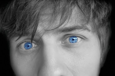 blue eyed man staring eerily