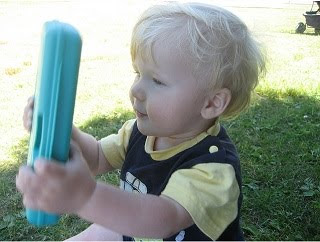 Image: Jacob playing with his baby wipes by AmberStrocel, on Flickr