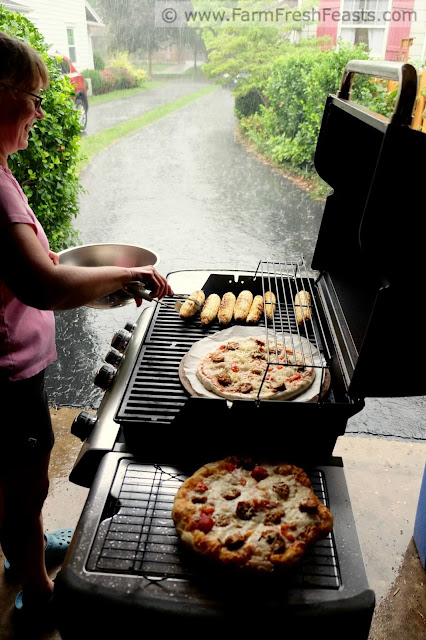 grilling pizza in the garage while it rains outside