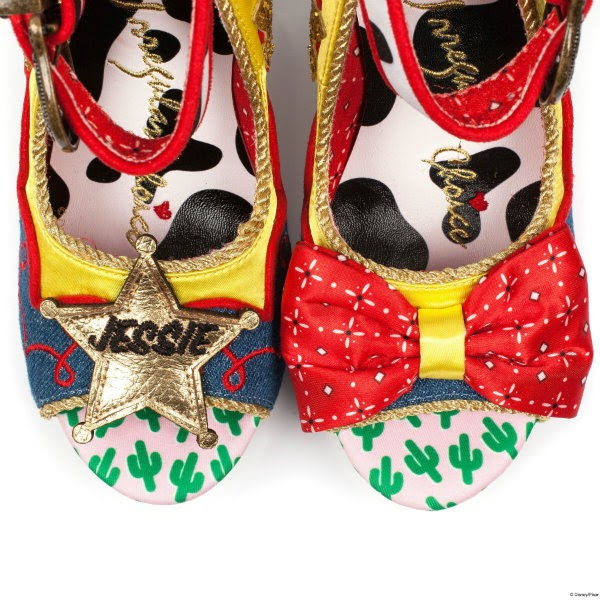 close up of toes of shoes with cow print lining, red bandana bow and sheriff badge across open toes
