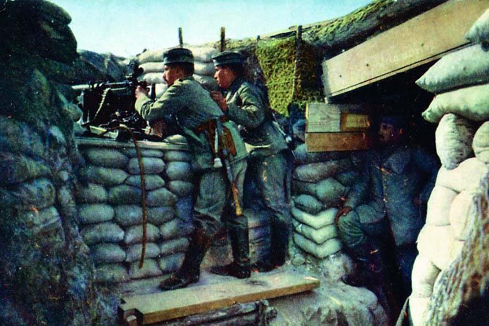 A German soldier posing with a machine gun.
