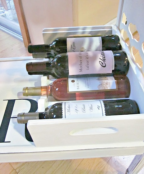 Creating wine storage for a DIY rolling bar cart.