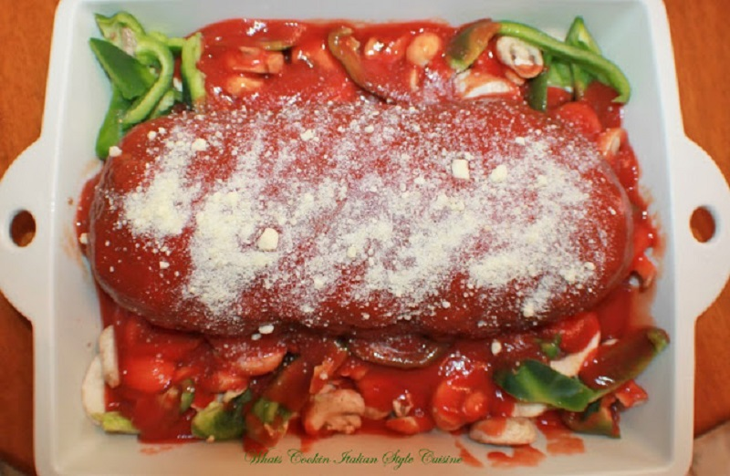 This is Italian flavored meatloaf stuffed with spinach, boiled eggs with tomato sauce rolled up and baked in the oven. This is a gourmet meatloaf that is worth the time and effort and delicious
