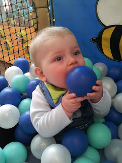 soft play, ball bit, baby in ball pit, eating ball