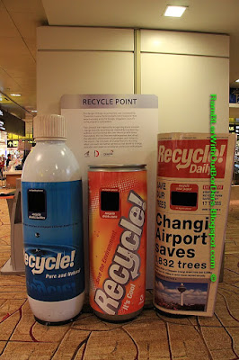 Recycling bins, departure hall, T2, Changi airport, Singapore