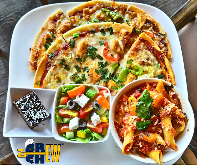 Big Pitcher Bangalore, chilli chicken pizza with pasta primavera house salad and bakery dessert