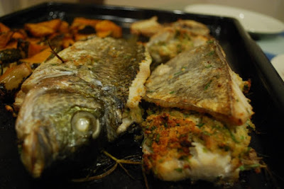 Thieboudienne is an African seafood recipe from Senegal of stuffed fish and seasoned rice