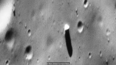 Phobos has got what some say is an artificial monolith on it.