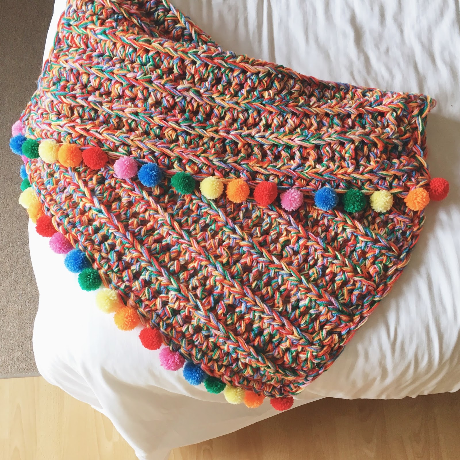 Super chunky rainbow blanket free tutorial lottie albert if you do use this pattern please tag your makes with lottieandalbertrainbowblanket so i can see what colours you choose how many pompoms you go for and bankloansurffo Choice Image