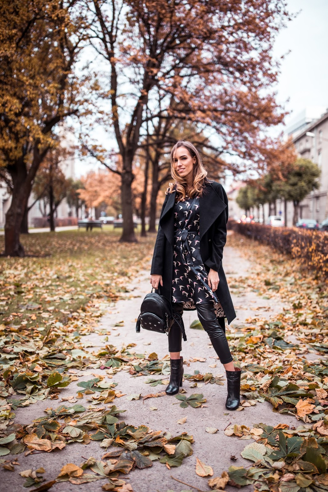 black dress over leather pants fall outfit street style