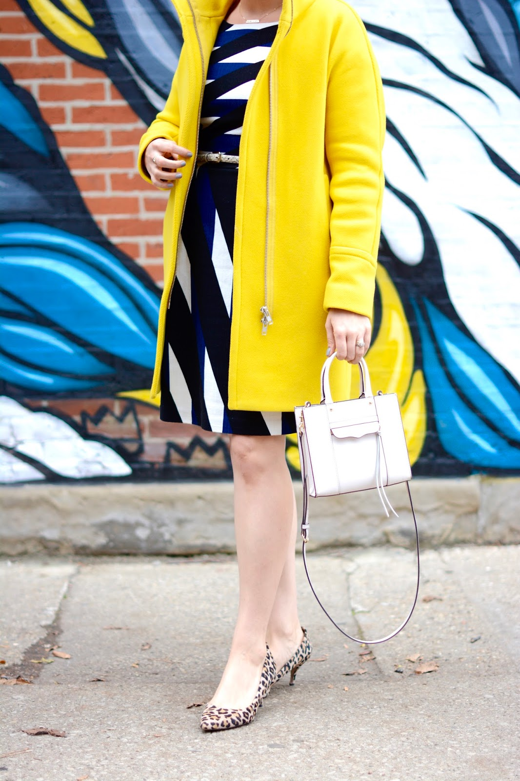 yellow j crew cocoon coat, trina turk dress, white Rebecca Minkoff Mini mab tote white, starburst karen walker sunglasses, gold bar necklace