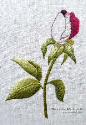 Using a gel pen to mask the previous guidelines on an thread painted (embroidered) rosebud (design by Trish Burr)