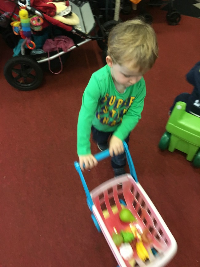 toddler-with-toy-shopping-trolley