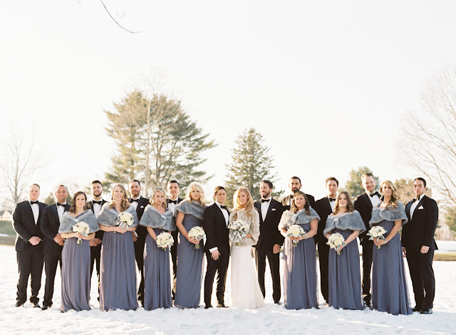 Large bridal party outside in the snow for Jenna and Chad's Willow Ridge Country Club Wedding | Karen Hill Photography